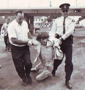 Peter Kormos being dragged away by police at a 1960s protest for public access to our lakeshores at Sherkston Beach on Lake Erie.  - from the photo collection of Peter Kormos