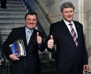 The 'austerity brothers', Canada's finance minister Jim Flaherty and Prime Minister Stephen Harper. It means more bags of gold for the upper one per cent and austerity for most of the rest of us.