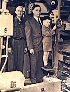 A young Henry Burgoyne with his father, then Standard publisher Bill Burgoyne, starts the presses for another daily run.