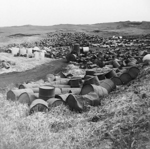 A historic photo of barrels of toxic chemicals to be buried at the Love Canal site before a school and heibhourhoood homes were later built around and on top.