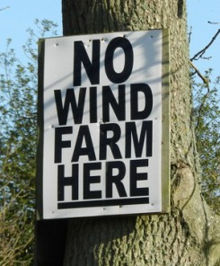 Signs like this have dotted the rural areas of Niagara, Ontario in recent years - a message that if you want to generate energy from wind here, get out of town
