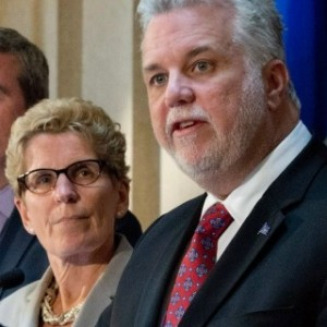 Ontario Premier Kathleen Wynne and Quebec Premier Philippe Couillard sign unprecedented bi-provincial agreement to tackle climate change.