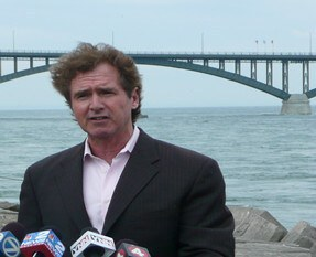 With Peace Bridge in background, U.S. Congressman Brian Higgins discusses Canana/U.S. border crossing challenges at a 2014 media conference