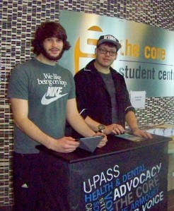 Ryan Krafft (left), director of student and community relations at Niagara College, and Alex Sobschak, communications director for the college's Student Administrative Council, recently ask other students to sign a petition for better regional transit. Photo by Doug Draper