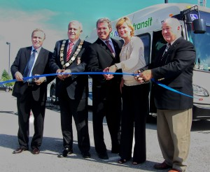 """Former Niagara regional public works commissioner Ken Brothers (left), along with Niagara-on-the-Lake regional councilor and former Niagara chair Gary Burroughs, former Port Colborne regional councilor Vance Badawey (now Niagara Centre MP), former Grimbsy regional councilor and former Niagara chair Debbie Zimmerman and St. Catharines regional councilor Tim Rigby, cut ribbon in September, 2011 for launch of """"pilot"""" inter-municipal transit system. All of them hoped then that we would be much further ahead in building a regional transit system by now. File photo by Doug Draper"""