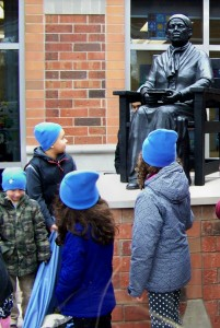 Children look up at a statue of Harriet Tubman unveiled February 9th, 2016 at a St. Catharines school named after her.