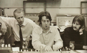 George Martin, with Paul McCartney and Ringo Starr at Abbey Road studios in the late 1960s.