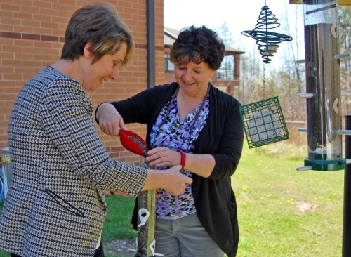Brock University researchers Kerrie Pickering, left, and Marcie Jacklin fill a bird feeder at the Woodlands of Sunset long-term care facility in Welland. Photo courtesy of Brock University