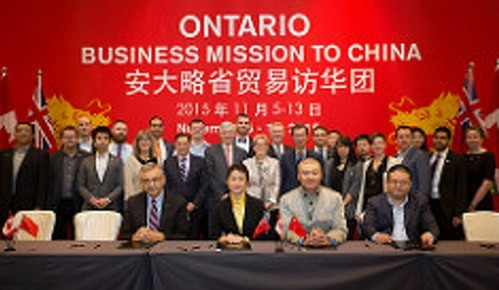 Ontario Premier Kathleen Wynne in the second row, in China last November 2016, cutting business deals with numerous other Chinese and Ontario corporate reps on hand.