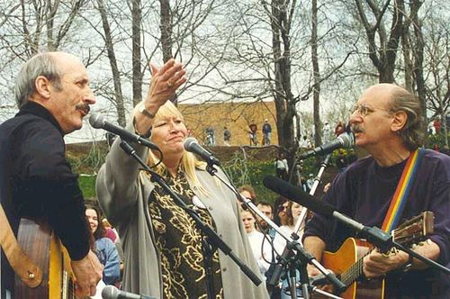 """Peter, Paul & Mary lead thousands in singing 'If I Had A Hammer' and """"Where Have All The Flowers Gone"""" at a 25th commemoration gathering in 1995 at Kent State University"""
