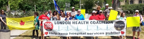Ontario residents rallying to save hospital services this past May 31st in front of provincial legislature