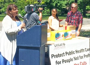 Ontario Health Coalition director Natalie Mehra speaks at May 31st Queen's Park rally for saving hospital services