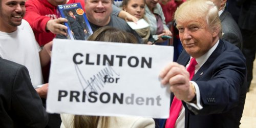 3-photos-of-donald-trump-holding-up-a-hillary-clinton-for-prison-sign.png