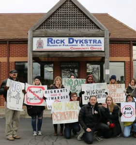 Niagara area voters rally for refugees in front of the St. Catharines constituency office of Harper Tory MP Rick Dykstra, who was ultimately defeated in last October's federal election. File photo by Doug Draper