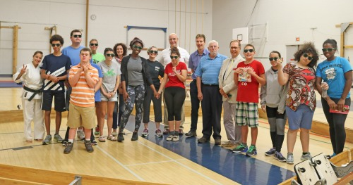 A group of campers from the Autism Spectrum Disorder Summer Movement Camp at Brock University pose with officials from Brock, the Region of Niagara and Niagara Recycling, which has funded the camp for the past 20 years.
