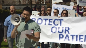 Doctors and patients rally for health care in from of Queen's Park legislative building in Toronto this spring