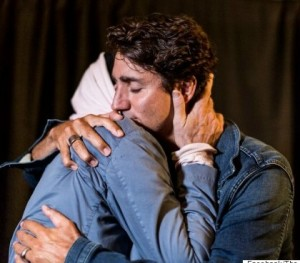 Prime Minister Justin Trudeau gives a hug of support to Gord Downie before the Hip takes the stage in Kingston this August 20th