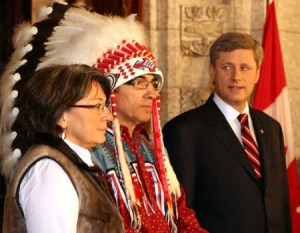 (080612) -- OTTAWA, June 12, 2008 (Xinhua) -- Canadian Prime Minister Stephen Harper (R) and Assembly of First Nations Chief Phil Fontaine (C) attend a news conference on Parliament Hill in Ottawa, Canada, June 11, 2008. Stephen Harper delivered an official apology Wednesday for thousands of aboriginal victims of residential schools in history. Residential school survivors and native representatives, some wearing traditional clothing, attended the apology ceremony. From the 1870s to the 1970s, about 150,000 aboriginal children were forcibly removed from their parents and sent to distant residential schools in a bid to assimilate them into Christian society. Many say they were abused mentally, physically and sexually at the schools. (Xinhua/Gao Rudong) (lyx/lhn)