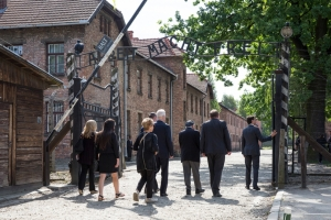 Trudeau, right, enters main gate to hellish Auschwitz concentration camp this July