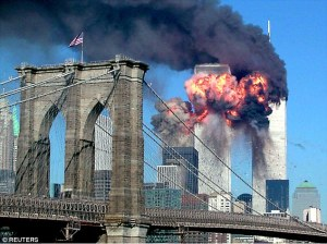 The twin towers of the World Trade Center in flames on the morning of 9/11