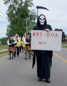 The Grim Reaper in this 2010 rally to save the Fort Erie Hospital ultimately got his way. That hospital is now a shell of what it was a decade ago. File photo by Doug Draper