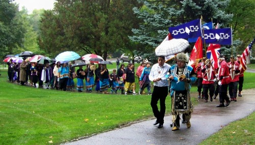 Members of the region's Indigenous communities proceed through Queenston Height's Park to the site of the about to be unveiled Landscape of Nations commemorative memorial. Photo by Doug Draper