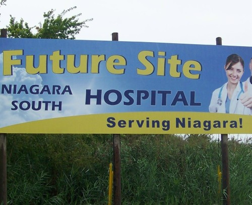 A fading billboard sign where new Niagara Falls hospital is supposed to go