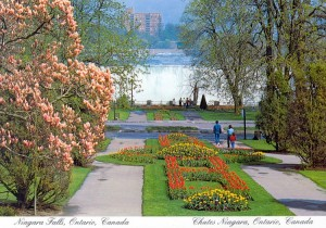 Niagara Park's Queen Victoria Park with tulips in spring and waters of American Falls in background.