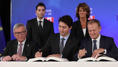 Prime Minister Justin Trudeau signs trade deal with his European Union counterparts.