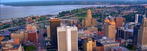 The skyline of downtown Buffalo, New York with Niagara, Ontario across the river in the background.