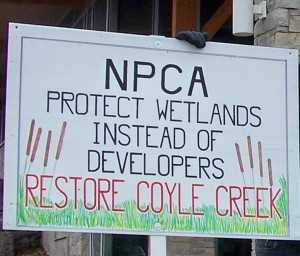 One of the many signs citizens held up this January during a meeting of the Niagara Peninsula Conservation Authority's board of directors. File photo by Doug Draper