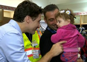Canadian Prime Minister Justin Trudeau greets Syrian refugees arriving at Toronto airport last year.