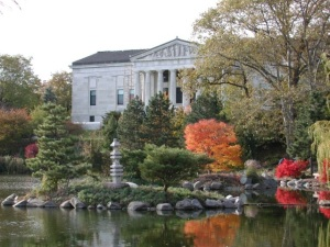 The Buffalo History Museum, overlooking a pond and the south end of the city's scenic Delaware Park.