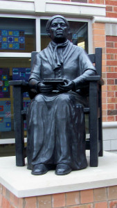 Statue of Harriet Tubman, seated in a chair and resting a book in her hands, was commissioned by the District School Board of Niagara from former Niagara residents and artists Frank Rekrut and Laura Thompson, who now live and own an art studio in Florence, Italy. It was unveiled a year ago this February at Harriet Tubman Public School in St. Catharines. File photo by Doug Draper