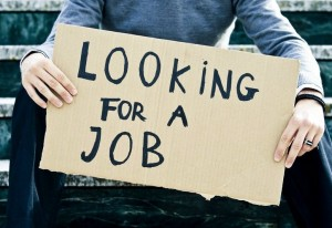 young-businessman-holding-sign-looking-for-a-job