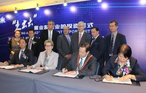 "Ontario Premier Kathleen Wynne with Niagara Falls Mayor Jim Diodati in China in November 2015, participating in the signing of a ""memorandum of understanding"" for the controversial Thundering Waters development project in Niagara Falls, Ontario. The contents of that Memorandum of Understanding have yet to be publicly disclosed."